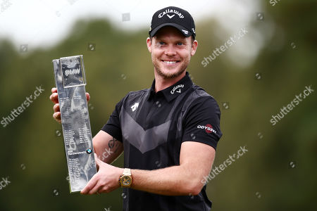 Danny Willett of England celebrates with the trophy.