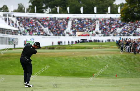Danny Willett of England plays into the 18th hole.