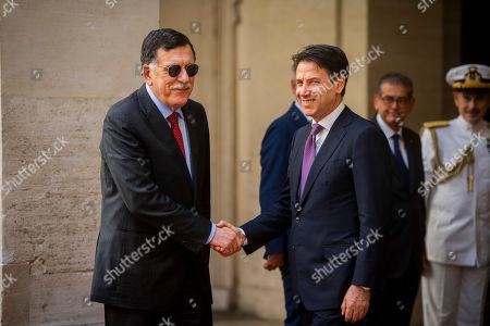 Stock Photo of Libya's UN-recognised Prime Minister Fayez al-Sarraj with Italian Prime Minister Giuseppe Conte