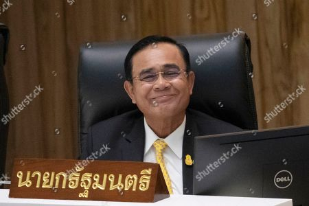 Stock Image of Thailand's Prime Minister Prayuth Chan-ocha smiles before answering a question at parliament in Bangkok, Thailand, . Prayuth has come under fire in a parliamentary debate because he omitted a key phrase in taking his oath of office in July, but dodged opposition demands to explain why he had left it out