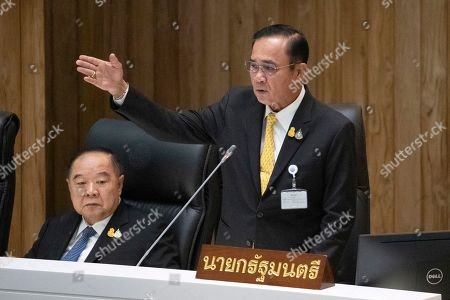 Stock Photo of Prayuth Chan-ocha, Prawit Wongsuwan. Thailand Deputy Prime Minister Prawit Wongsuwan, left, listens as Thailand's Prime Minister Prayuth Chan-ocha answers a question at parliament in Bangkok, Thailand, . Prayuth has come under fire in a parliamentary debate because he omitted a key phrase in taking his oath of office in July, but dodged opposition demands to explain why he had left it out