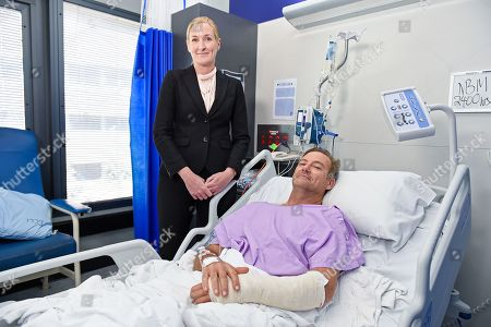 Surgeon Nicola Ward and bushwalker Neil Parker at Princess Alexandra Hospital in Brisbane, Australia, 18 September 2019. Neil Parker, 54, fractured his leg and wrist in the six-metre fall on Sunday while walking by himself in Cabbage Tree Creek on Mt Nebo, northwest of Brisbane.