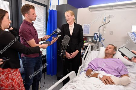 Surgeon Nicola Ward (centre) speaks to the media at Princess Alexandra Hospital in Brisbane, Australia, 18 September 2019. Neil Parker, 54, fractured his leg and wrist in the six-metre fall on Sunday while walking by himself in Cabbage Tree Creek on Mt Nebo, northwest of Brisbane.