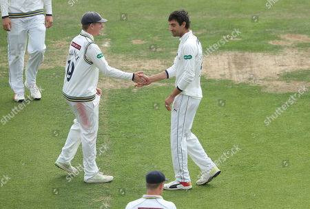 Yorkshire's Duanne Olivier (right) celebrates taking the wicket of Kent's Ollie Robinson with Gary Ballance