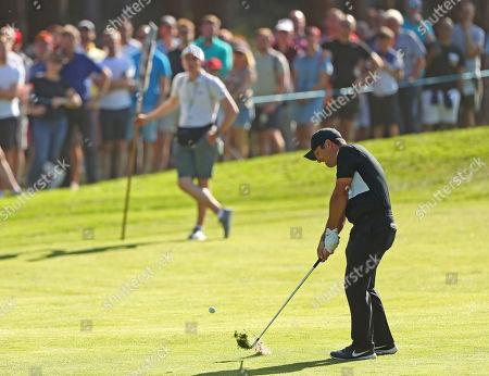 VIRGINIA WATER, ENGLAND. 21 SEPTEMBER 2019: Francesco Molinari takes a shot from the fairway during round three of the BMW PGA Championship, European Tour Golf Tournament at Wentworth Golf Club, Virginia Water, Surrey, England.