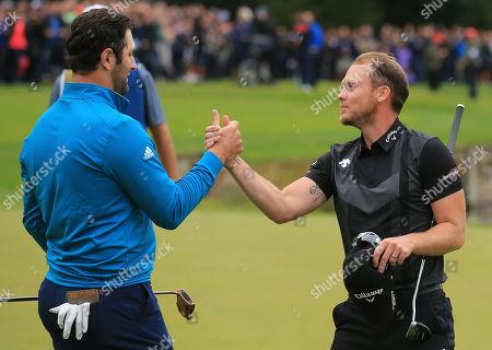 VIRGINIA WATER, ENGLAND. 22 SEPTEMBER 2019: Jon Rahm congratulates Danny Willett during round four of the BMW PGA Championship, European Tour Golf Tournament at Wentworth Golf Club, Virginia Water, Surrey, England.