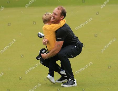 VIRGINIA WATER, ENGLAND. 22 SEPTEMBER 2019: Danny Willett celebrates winning the BMW PGA Championship, European Tour Golf Tournament at Wentworth Golf Club, Virginia Water, Surrey, England.
