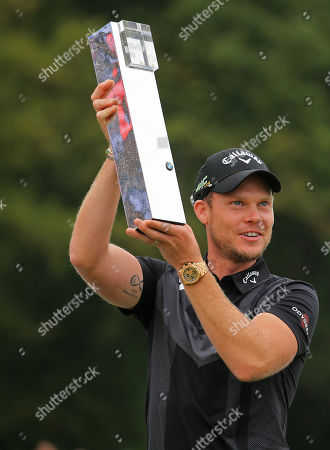 VIRGINIA WATER, ENGLAND. 22 SEPTEMBER 2019: Danny Willett poses with the trophy during round four of the BMW PGA Championship, European Tour Golf Tournament at Wentworth Golf Club, Virginia Water, Surrey, England.