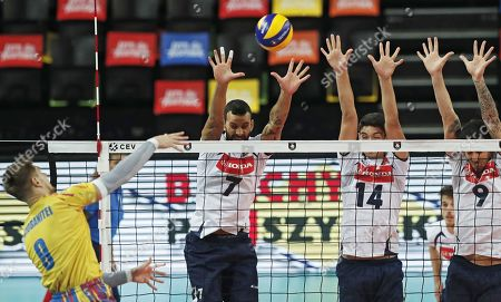 Stock Image of Marco Evan Ferreira, Guilherme Menezes and Joao Simoes (R) of Portugal in action against Robert Adrian Aciobanitei (L) of Romania during the EuroVolley Men 2019 match between Portugal and Romania in Montpellier, France, 18 September 2019.