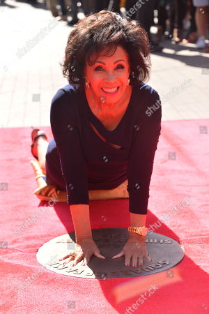 Welsh singer Dame Shirley Bassey unveils her bronze handprints in the Square of Fame at SSE Wembley. The star first performed at the venue 60 years ago in a performance that inaugurated the Empire Pool, Wembley (as it was known then), as a music and entertainment venue, and began its reputation as one of the world's most iconic concert venues. The unveiling marks 60 momentous years of The SSE Arena, Wembley in Wembley Park, North West London's world-famous, dynamic cultural neighbourhood.