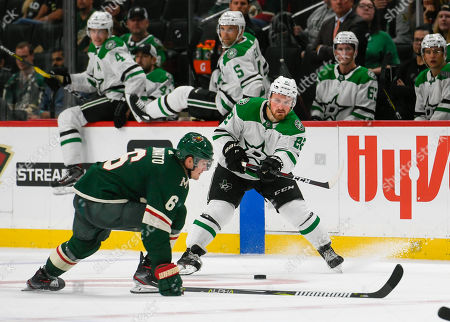 Dallas Stars winger Adam Mascherin, left, pass is blocked by Minnesota Wild winger Ryan Donato during the third period of a preseason NHL hockey game, in St. Paul, Minn. Dallas won 2-1 in overtime