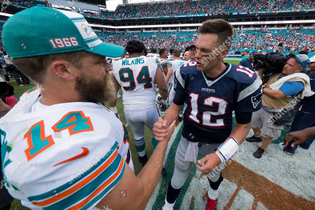 Tom Brady #12 of New England and Ryan Fitzpatrick #14 of Miami chat after the NFL football game between the Miami Dolphins and New England Patriots at Hard Rock Stadium in Miami Gardens FL. The Patriots defeated the Dolphins 43-0