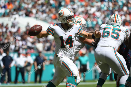 Ryan Fitzpatrick #14 of Miami in action during the NFL football game between the Miami Dolphins and New England Patriots at Hard Rock Stadium in Miami Gardens FL. The Patriots defeated the Dolphins 43-0
