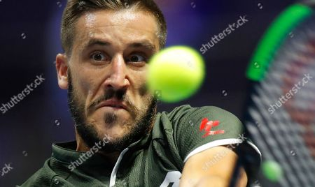 Damir Dzumhur of Bosnia and Herzegovina returns the ball to Mikhail Kukushkin of Kazakhstan during the St. Petersburg Open ATP tennis tournament match in St.Petersburg, Russia
