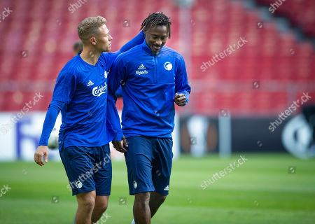Stock Photo of FC Copenhagen's Viktor Fischer (L) and Dame N'Doye attend a training session in Copenhagen, Denmark, 18 September 2019. FC Copenhagen will play against FC Lugano in their UEFA Europa League match on 19 September.