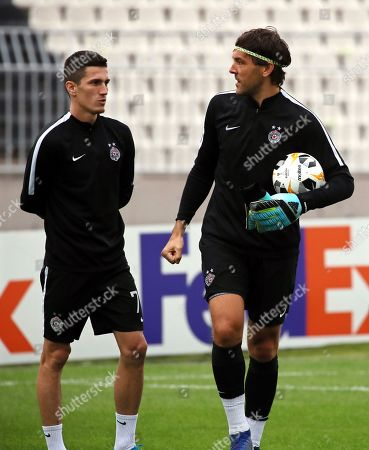 Partizan Belgrade players Slobodan Urosevic (L) and goalkeeper Vladimir Stojkovic (R) attend their team's training session in Belgrade, Serbia, 18 September 2019. Partizan Belgrade will face AZ Alkmaar in their UEFA Europa League soccer match on 19 September 2019.