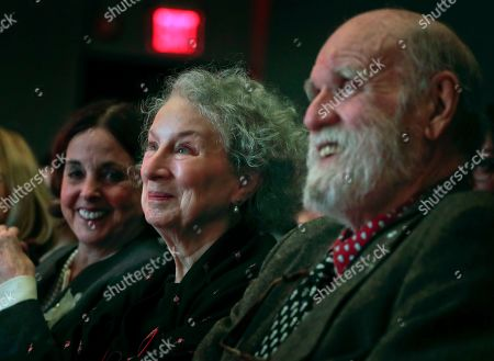 Author Margaret Atwood, center, appears with her editor Nan Talese, left, and husband Graeme Gibson as she is introduced for the Ivan Sandrof Lifetime Achievement Award at the National Book Critics Circle awards ceremony in New York. Gibson, a Canadian novelist and conservationist has died. His death was announced by Doubleday, which has published both Gibson and Atwood. He was 85 and had been suffering from dementia