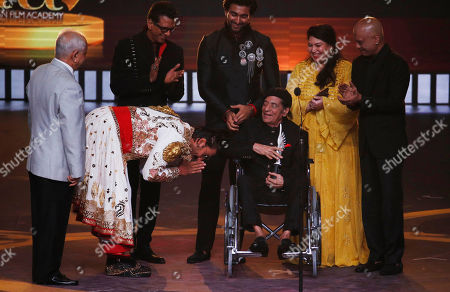 Ranveer Singh, Jagdeep. Bollywood actor Ranveer Singh, left, bows after presenting Life time Achievement award to actor Jagdeep during the 20th International Indian Film Academy (IIFA) awards ceremony in Mumbai, India