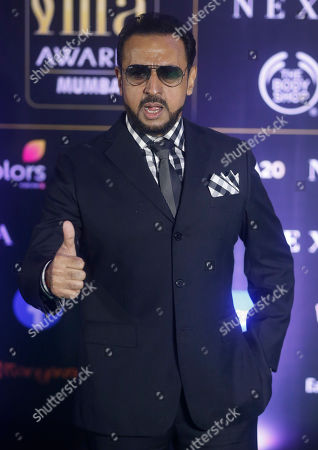 Bollywood actor Gulshan Grover stands for photographs during the 20th International Indian Film Academy (IIFA) awards ceremony in Mumbai, India