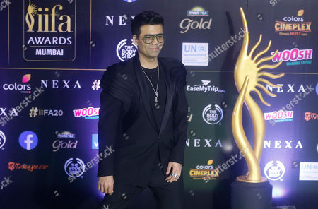 Stock Picture of India filmmaker Karan Johar stands for photographs during the 20th International Indian Film Academy (IIFA) awards ceremony in Mumbai, India