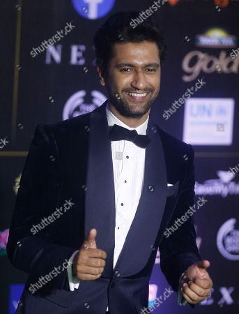 Vicky Kaushal. Bollywood actor Gulshan Grover stands for photographs as he arrives to attend the 20th International Indian Film Academy (IIFA) awards ceremony in Mumbai, India