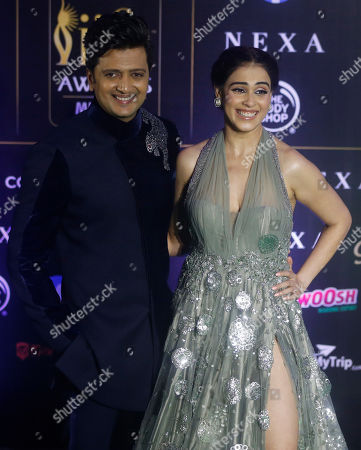 Stock Image of Ritesh Deshmukh, Genelia Dsouza. Bollywood actor Ritesh Deshmukh, left, stands with his wife Genelia Dsouza as they arrive to attend the 20th International Indian Film Academy (IIFA) awards ceremony in Mumbai, India