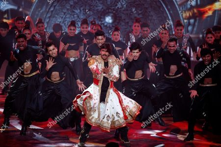 Bollywood actor Ranveer Singh, center, performs during the 20th International Indian Film Academy (IIFA) awards ceremony in Mumbai, India
