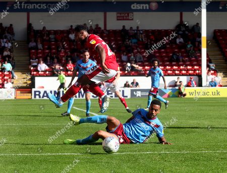 Wes McDonald of Walsall with James Perch of Scunthorpe  during the Sky Bet  League Two match  Walsall v Scunthorpe United at The Bank's Stadium, Walsall, West Midlands, UK 21/09/2019