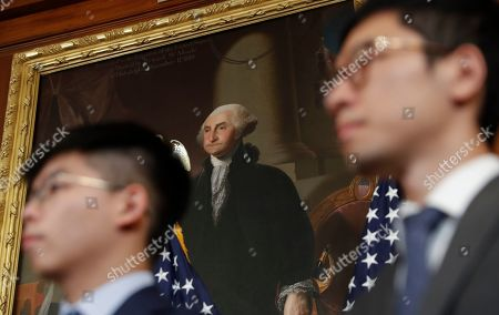 Joshua Wong, Nathan Law. Hong Kong activist Joshua Wong, left, and Nathan Law, right, stand in front of a portrait of President George Washington during a news conference on human rights in Hong Kong on Capitol Hill in Washington