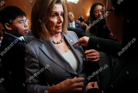 Nancy Pelosi, Joshua Wong, Denise Ho, Nathan Law. House Speaker Nancy Pelosi is given a lapel pin by a Hong Kong activist following a news conference on human rights in Hong Kong on Capitol Hill in Washington, . Behind Pelosi is Hong Kong activist Joshua Wong