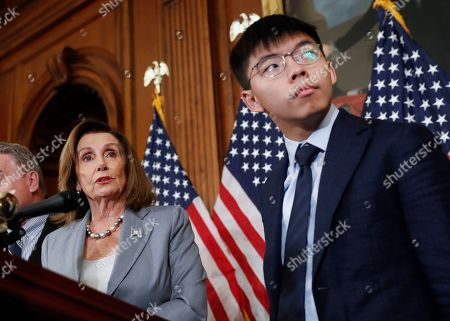 Nancy Pelosi, Joshua Wong, Denise Ho, Nathan Law. House Speaker Nancy Pelosi, left, with Hong Kong activist Joshua Wong and other members of Congress during a news conference on human right in Hong Kong on Capitol Hill in Washington