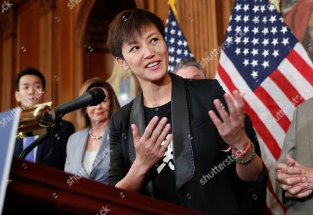 Hong Kong activist Denise Ho, center, speaks as she is joined by members of Congress during a news conference on human rights in Hong Kong on Capitol Hill in Washington