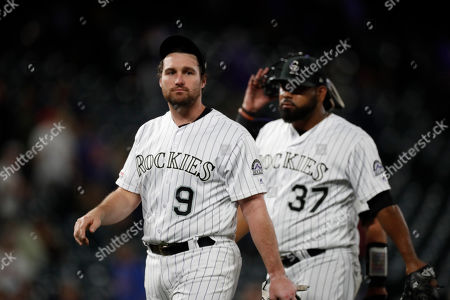 Stock Picture of R m. Colorado Rockies first baseman Daniel Murphy (9) in the ninth inning of a baseball game, in Denver. The Rockies won 9-4