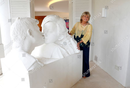 Daniele Thompson, Monegasque film director and daughter of French film director Gerard Oury, poses in front of the sculpture 'The Kiss' by the Chinese artist Wang Du in Saint-Tropez, France, 18 September 2019. Daniele Thompson sells her house 'Villa Les Oliviers' and the furniture will be sold separately at auction on 05 October 2019.