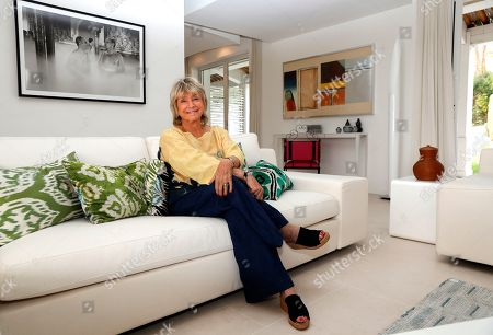 Daniele Thompson, Monegasque film director and daughter of French film director Gerard Oury, poses in front of a photograph of the movie release by her father 'La grande vadrouille' in Saint-Tropez, France, 18 September 2019. Daniele Thompson sells her house 'Villa Les Oliviers' and the furniture will be sold separately at auction on 05 October 2019.