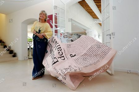 Daniele Thompson, Monegasque film director and daughter of French film director Gerard Oury, poses in front of the sculpture 'The Business' by the Chinese artist Wang Du in Saint-Tropez, France, 18 September 2019. Daniele Thompson sells her house 'Villa Les Oliviers' and the furniture will be sold separately at auction on 05 October 2019.