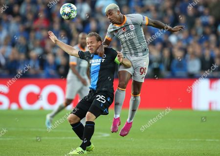 Brugge's Ruud Vormer, left, and Galatasaray's Mario Lemina vie for the ball during the Champions League group A soccer match between Club Brugge and Galatasaray at the Jan Breydel stadium in Bruges, Belgium