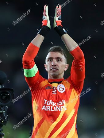 Galatasaray's goalkeeper Fernando Muslera applauds fans at the end of the Champions League group A soccer match between Club Brugge and Galatasaray at the Jan Breydel stadium in Bruges, Belgium