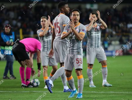 Galatasaray's Yuto Nagatomo applauds fans at the end of the Champions League group A soccer match between Club Brugge and Galatasaray at the Jan Breydel stadium in Bruges, Belgium