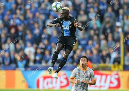Brugge's Krepin Diatta heads the ball past Galatasaray's Yuto Nagatomo during the Champions League group A soccer match between Club Brugge and Galatasaray at the Jan Breydel stadium in Bruges, Belgium