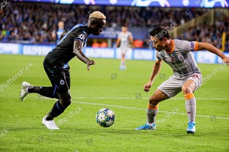Krepin Diatta (L) of Brugge in action against Yuto Nagatomo (R) of Galatasaray during the UEFA Champions League group A soccer match between Club Brugge and Galatasaray Istanbul in Brugge, Belgium, 18 September 2019.
