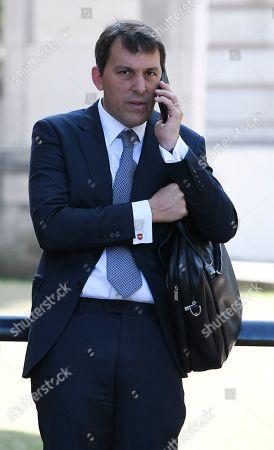 Stock Photo of Economic Secretary to the Treasury John Glen MP outside the Treasury
