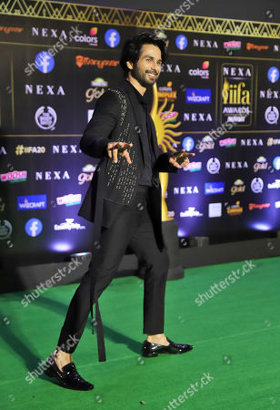 Stock Photo of Bollywood actor Shahid Kapoor arrives to attend the 20th International Indian Film Academy (IIFA) awards ceremony in Mumbai, India
