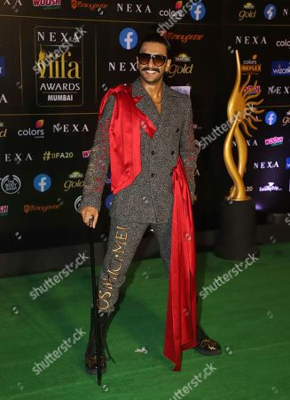 Bollywood actor Ranveer Singh stands for photographs as he arrives to attend the 20th International Indian Film Academy (IIFA) awards ceremony in Mumbai, India