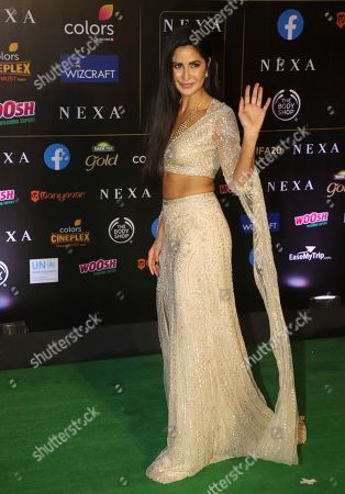 Bollywood actress Katrina Kaif stands for photographs as she arrives to attend the 20th International Indian Film Academy (IIFA) awards ceremony in Mumbai, India