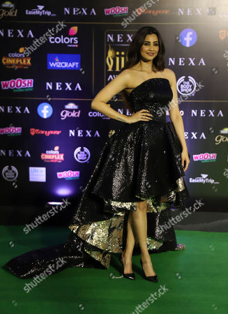 Indian actress Nushrat Bharucha stands for photographs as she arrives to attend the 20th International Indian Film Academy (IIFA) awards ceremony in Mumbai, India