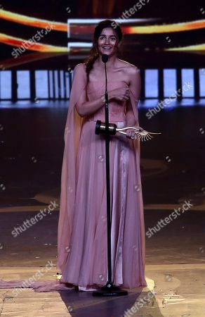 Stock Photo of Alia Bhatt reacts after receiving Best Female Actor in leading role during the 20th International Indian Film Academy (IIFA) awards in Mumbai, India, 18 September 2019. The IIFA awards are prizes presented by the International Indian Film Academy every year to honour artistic and technical excellence of professionals in Bollywood.