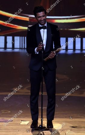 Vicky Kaushal reacts after receiving award for Supporting Role in male category during the 20th International Indian Film Academy (IIFA) awards in Mumbai, India, 18 September 2019. The IIFA awards are prizes presented by the International Indian Film Academy every year to honour artistic and technical excellence of professionals in Bollywood.