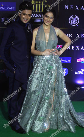 Stock Photo of Ritesh Deshmukh (L) and wife Genelia D'Souza arrive for the 20th International Indian Film Academy (IIFA) awards ceremony in Mumbai, India, 18 September 2019. The IIFA awards are prizes presented by the International Indian Film Academy every year to honour artistic and technical excellence of professionals in Bollywood.