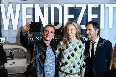 Stock Image of German actors Andre Hennicke, Petra Schmidt-Schaller and Harald Schrott take a selfie as they pose during a photocall for the premiere of the movie 'Wendezeit' (Turning Point) in Berlin, Germany, 18 September 2019. The movie Wendezeit screens on 02 October 2019 in German television station ARD on occasion of the anniversary of the fall of the Berlin wall 30 years ago.